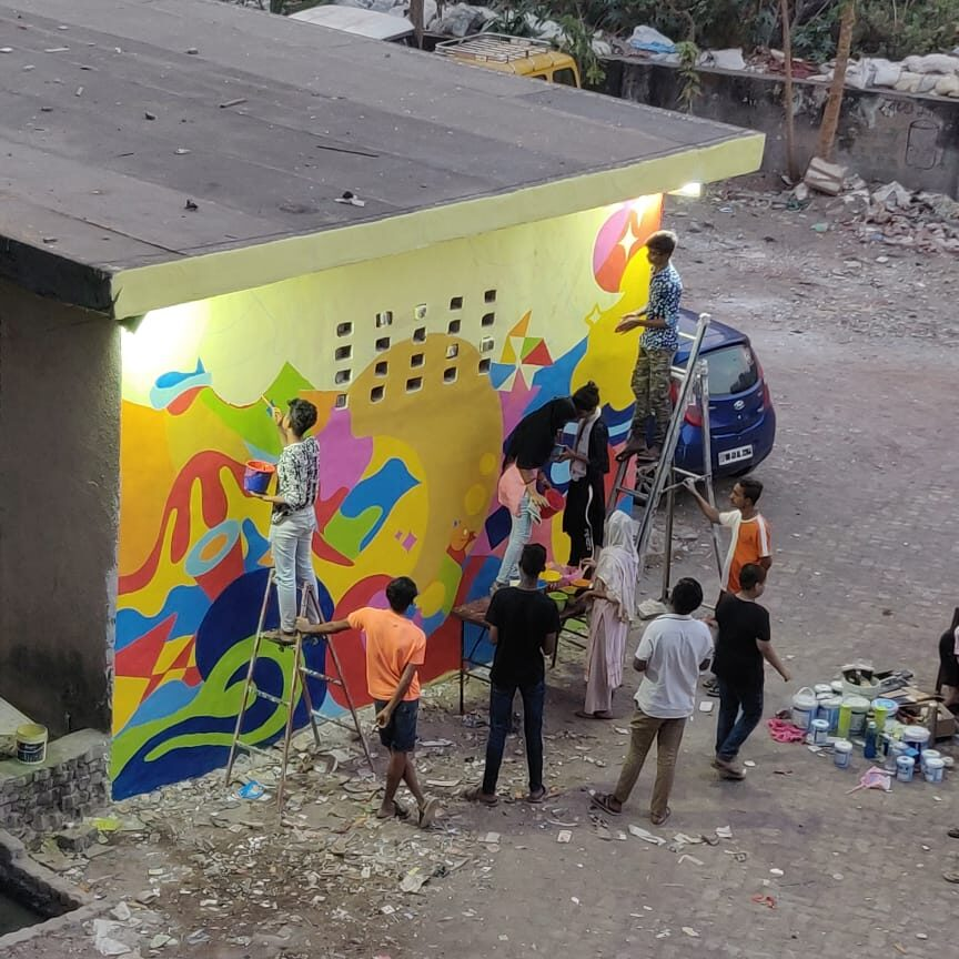 Residents participating in painting the mural